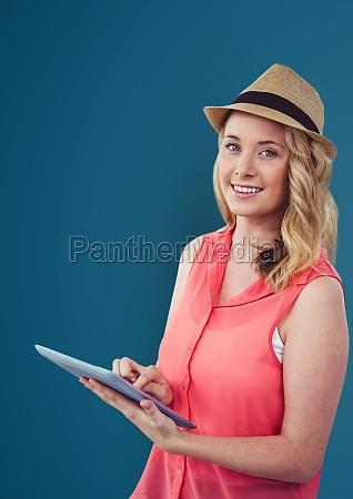 portrait of smiling woman holding digital