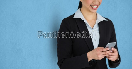 midsection of businesswoman using mobile phone