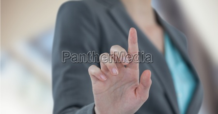 midsection of businesswoman touching futuristic screen