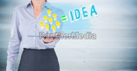 business woman mid section with lightbulb