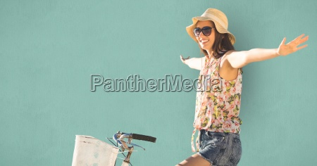 young woman with arms outstretched riding