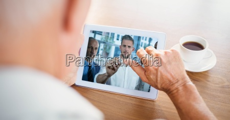 cropped image of businessman video conferencing