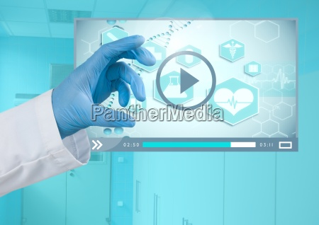 doctors hand touching medical video player