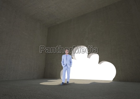 businessman standing by cloud shape doorway