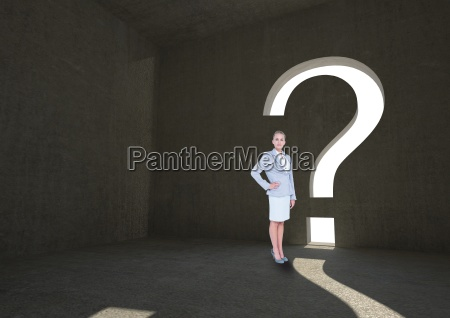 businesswoman standing by question mark shape