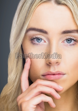 close up of woman thinking against