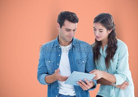 business people using digital tablet against