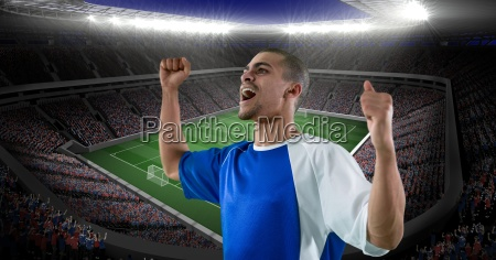 happy soccer player celebrating victory against