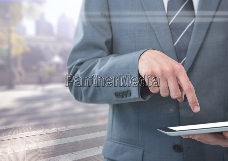 man mid section with tablet against