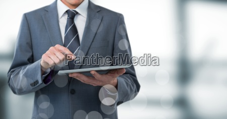 business man mid section with tablet