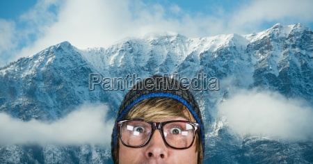 surprised hipster against snow covered mountains