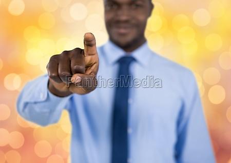 businessman touching screen over bokeh
