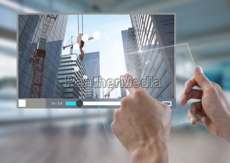 hand touching glass tablet city video