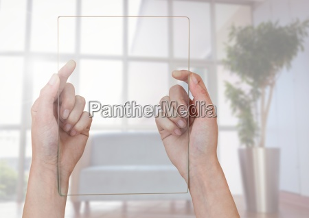 hands holding glass screen against window