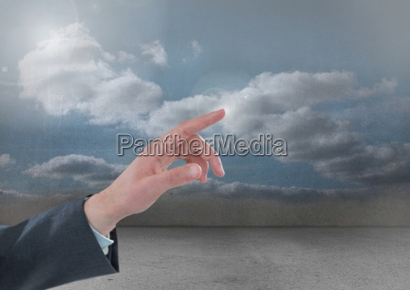 hand touching air of cloudy
