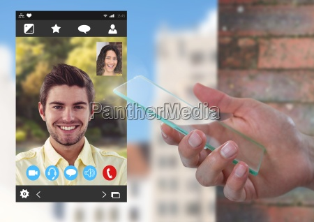 hand holding glass screen with social