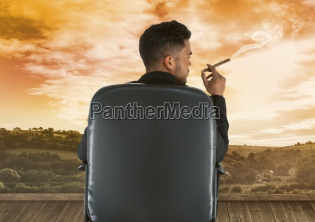 businessman sitting on chair and smoking