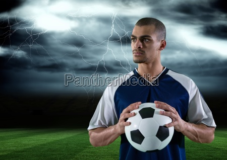 soccer player with ball on his