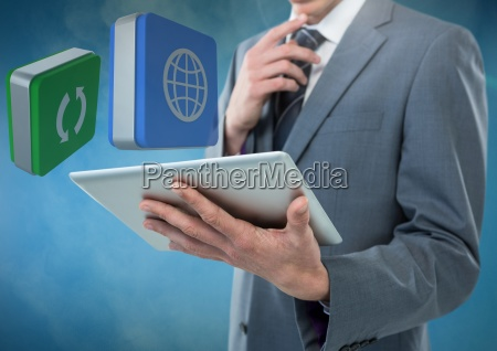 businessman holding tablet with apps icons