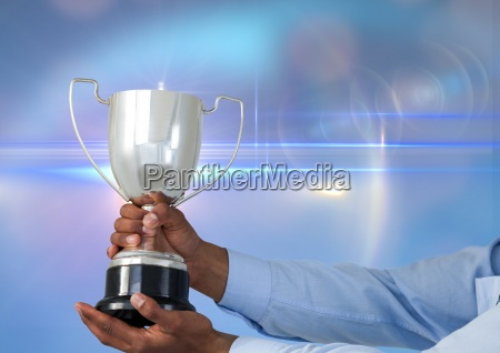 business hand with trophy blue background