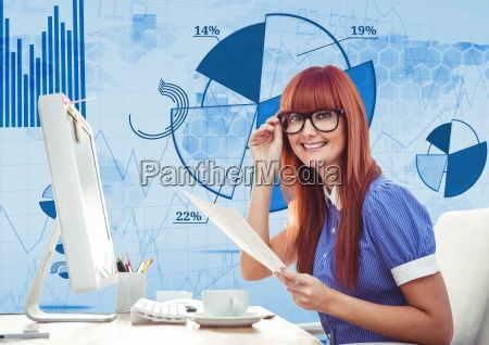 red hair woman with glasses working