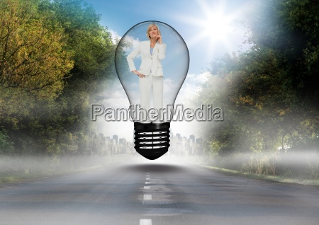 thoughtful businesswoman standing in bulb over