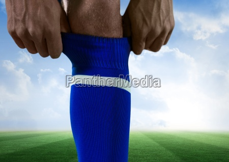 soccer player putting well his blue