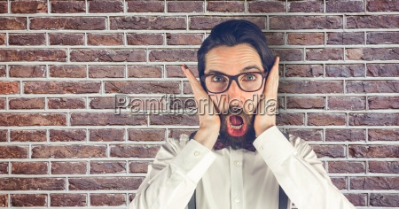 creative businessman looking surprised while standing