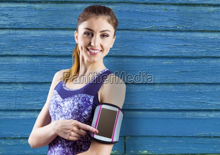 fitness young woman with blue wood