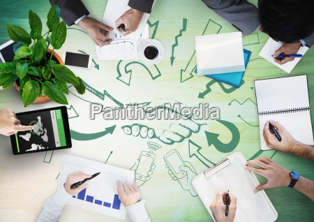 overhead of business team with green
