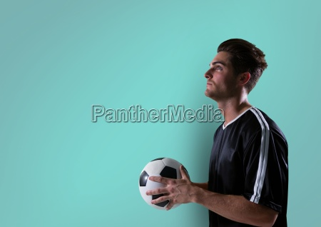soccer player looking up with ball