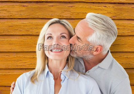 couple man giving kiss to the