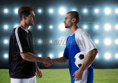 soccer players giving the hand in