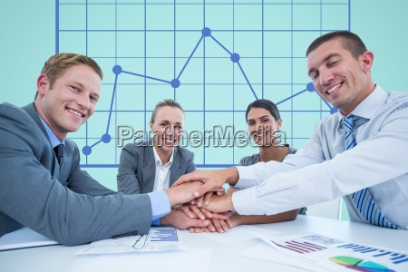 business workers gather their hands together