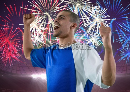 soccer player wining firework behind him