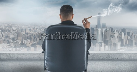 rear view of businessman sitting on