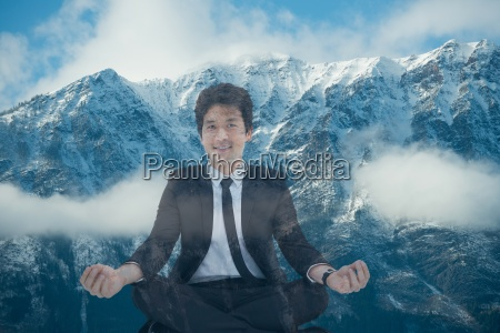 businessman doing yoga position in front