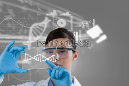 woman doctor watching dna graphics