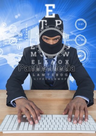 businessman with hood typing on keyboard