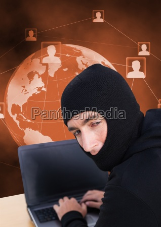 hacker using a laptop looking at