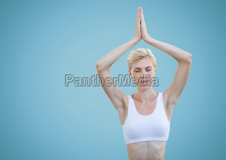 woman meditating against blue background