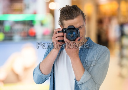 young photographer taking a photo store