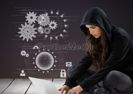 woman hacker using a laptop in
