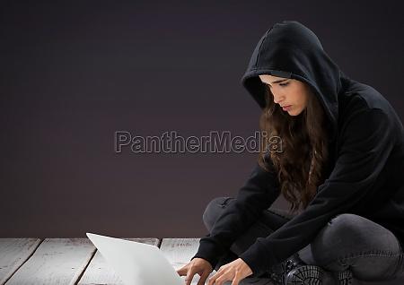 3d woman hacker using a laptop
