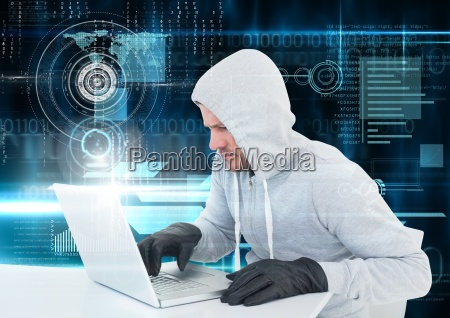 hacker with glove using a laptop