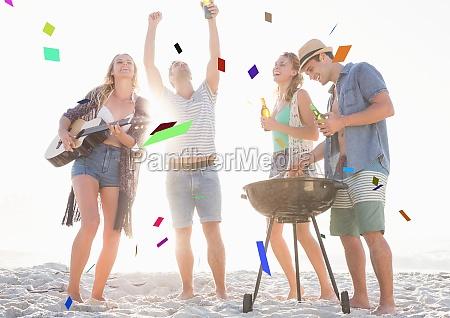 confetti against millennials at beach party