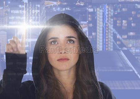 woman hacker touching a digital screen