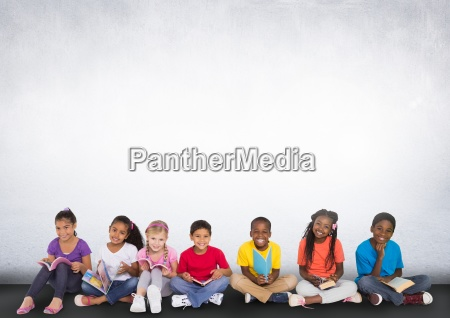 group of children sitting in front