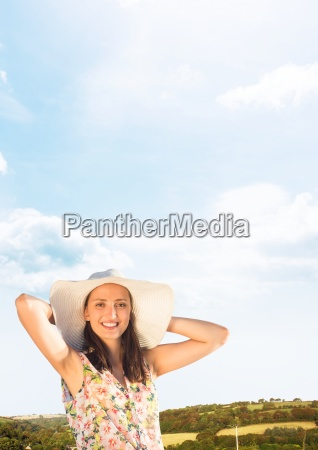millennial woman relaxing in sun hat