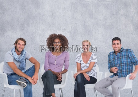 group of people sitting in front